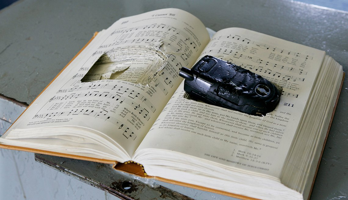 a prison contraband bible with the pages cut to hide a cell phone sits in a training room