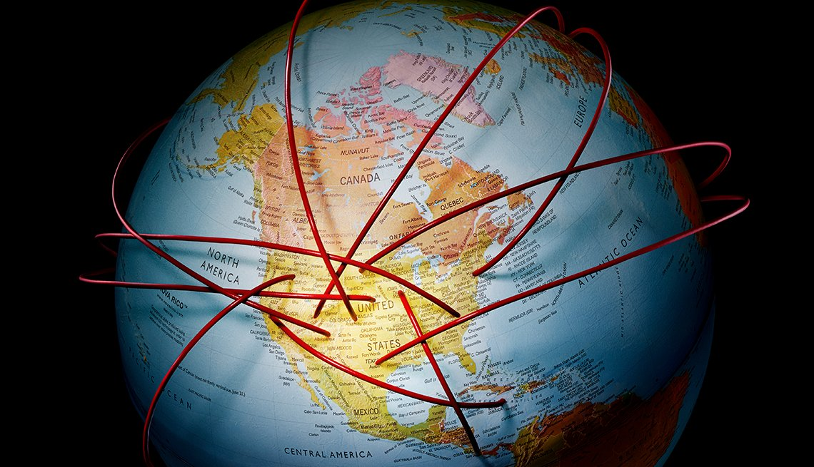 photo of a globe showing north america with thick three dimensional cords punching into it from places unseen around the globe