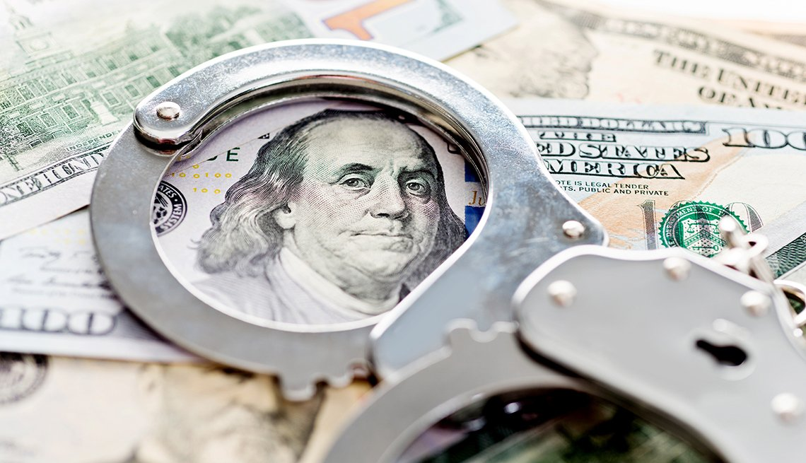 Handcuffs, money fraud concept