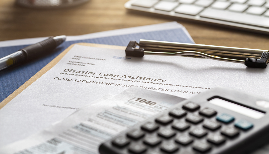 SBA - Small business administration economic injury disaster loan and emergency advance submitted application and tax forms from small business owner applying for relief due to the coronavirus
