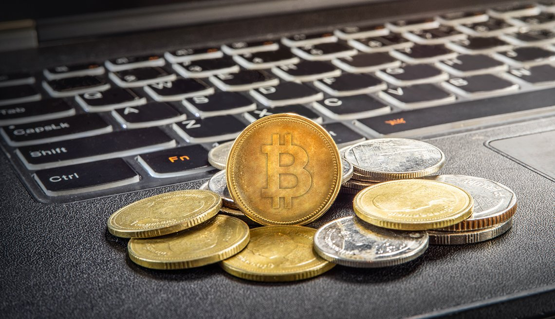 Cryptocurrency concept with bitcoins on a laptop