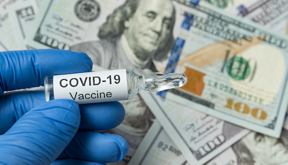 Coronavirus vaccine vial with gloves and money in the background