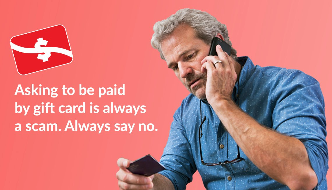 man talking on a mobile phone and holding a gift card with text that says asking to be paid by gift card is always a scam always say no