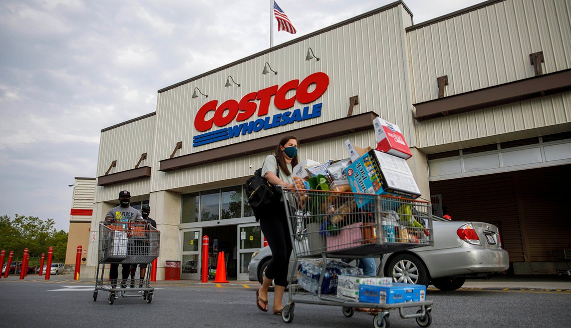 Shoppers wearing face masks leave a Costco wholesale store