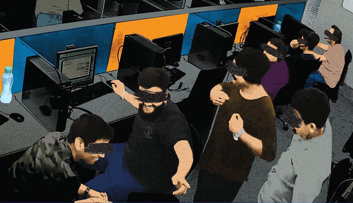 photo of fraud office staff laughing at one of their victims