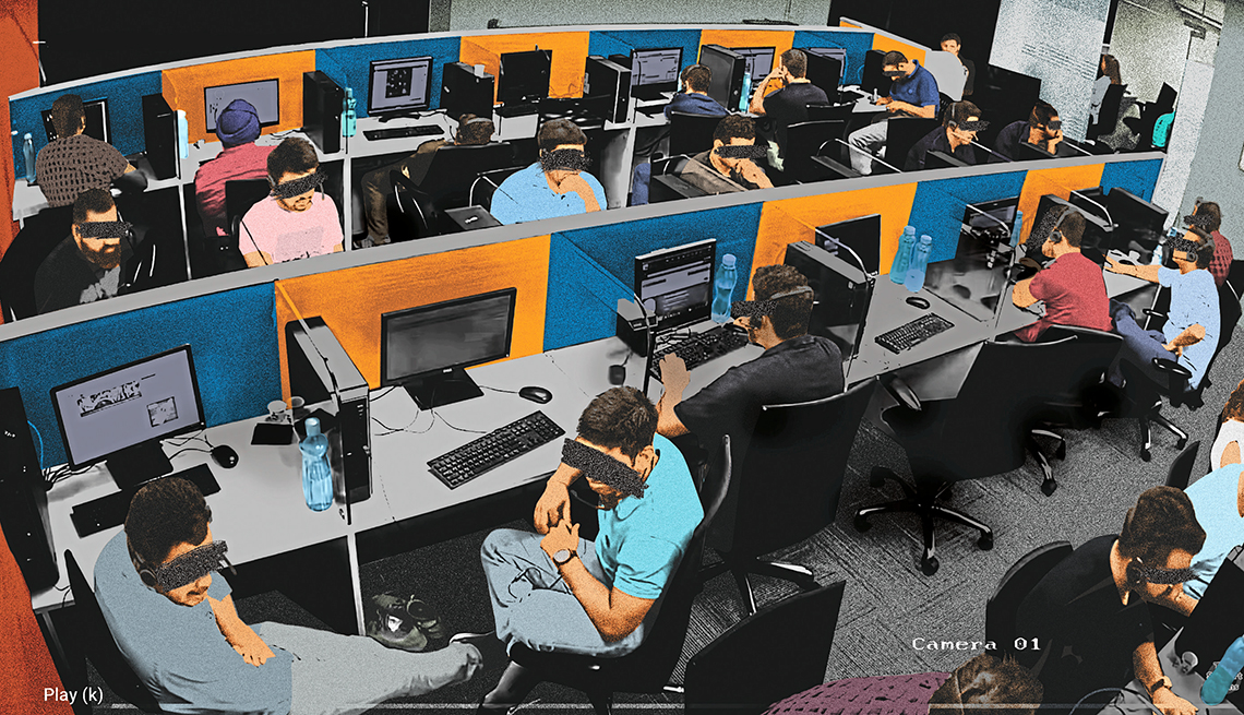 security camera still from a fraud factory office showing people working at cubicles with their faces obscured to hide their identity