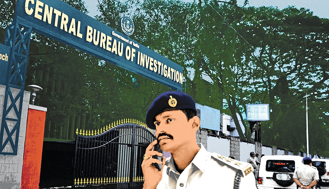 policeman in india talking on a mobile phone under the sign for the central bureau of investigations