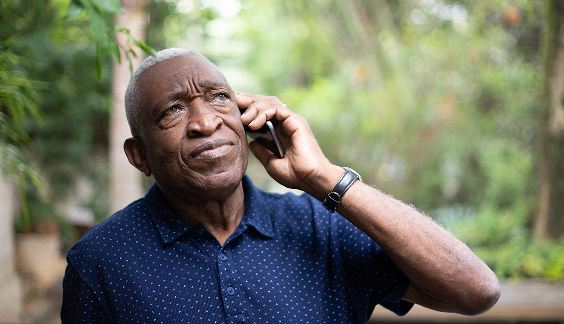 A man answering the phone unsure of who is on the phone