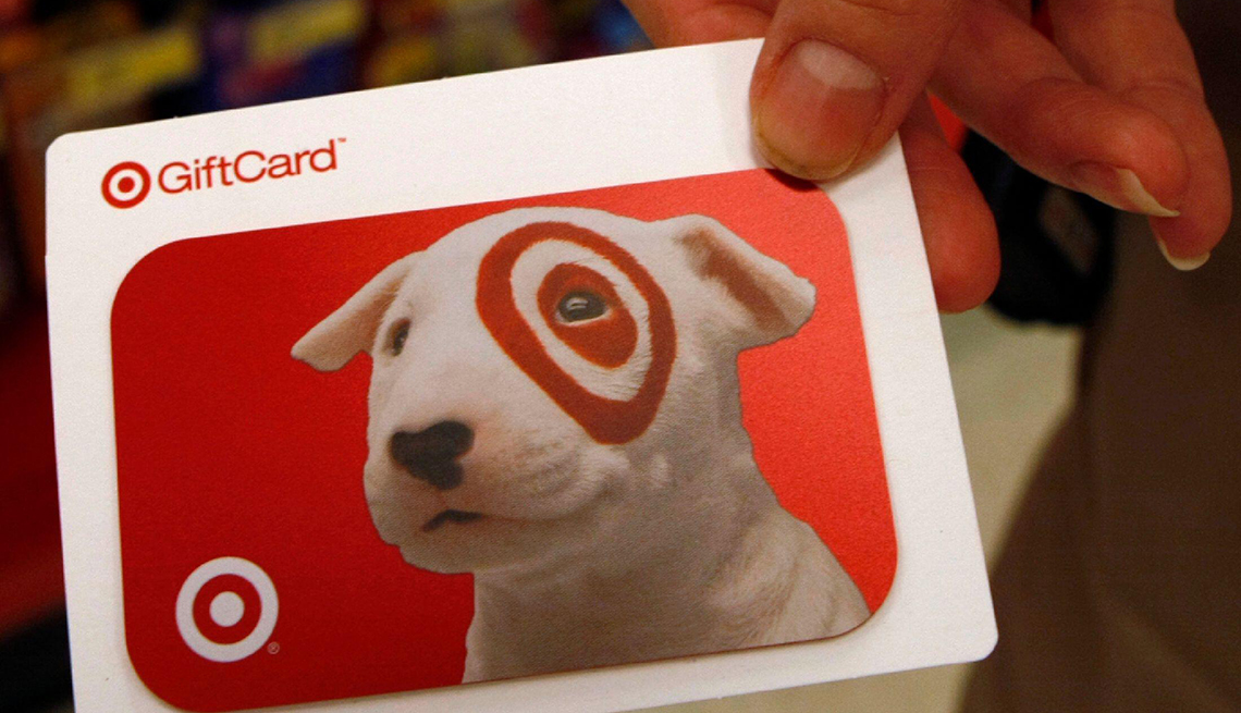 A Target gift card is displayed in a Target store