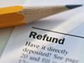 Tax form and pencil-tax tips for the unemployed