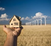Real estate concept with wind turbines in the background