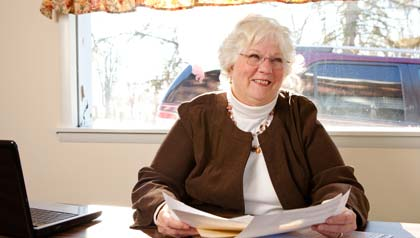 AARP Indiana Tax-Aide woman looking at paper work