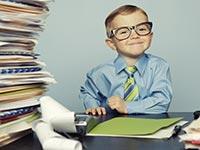 Kid accountant at desk, Kids and Tax Benefits Quiz