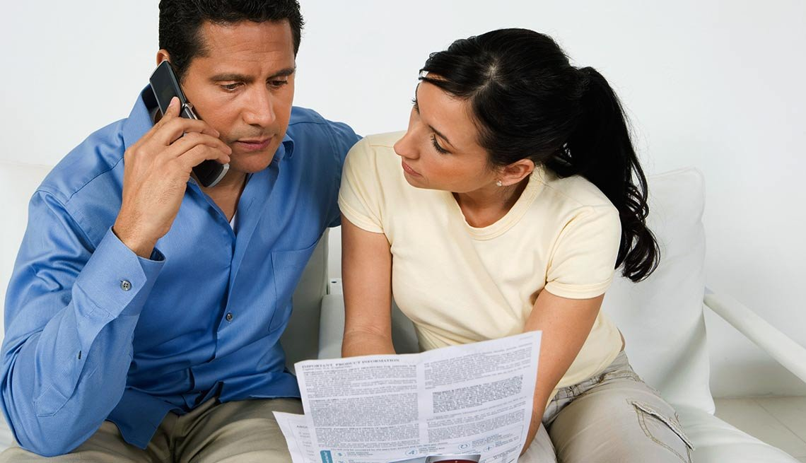 Couple With with tax forms on the phone, How to request tax extension