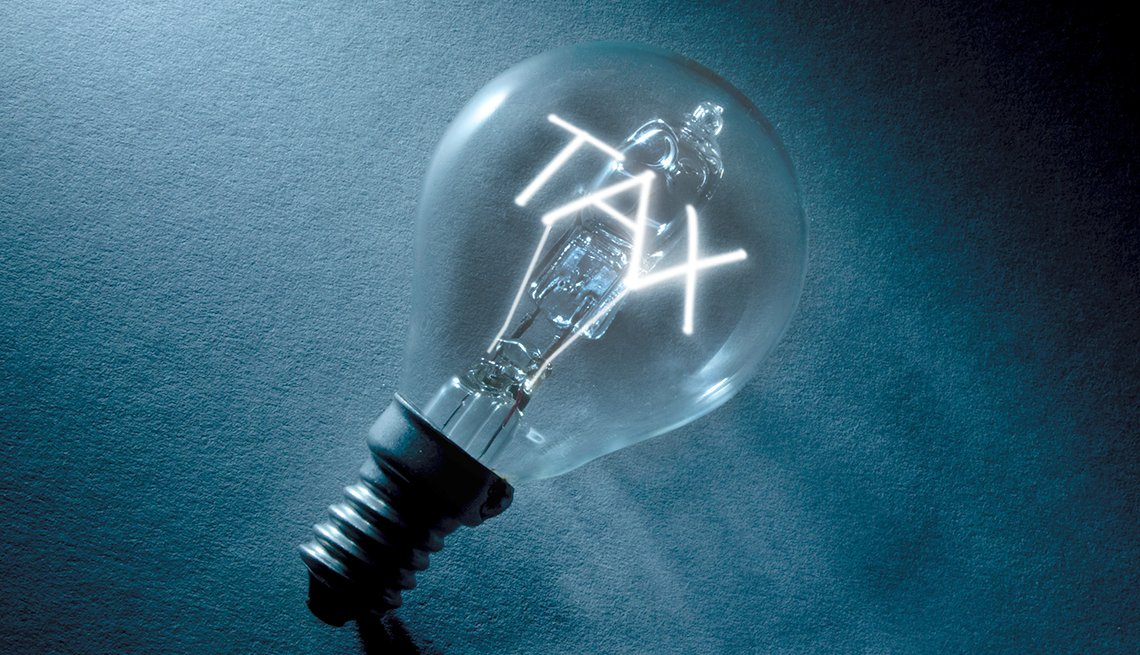 lightbulb with the word tax inside