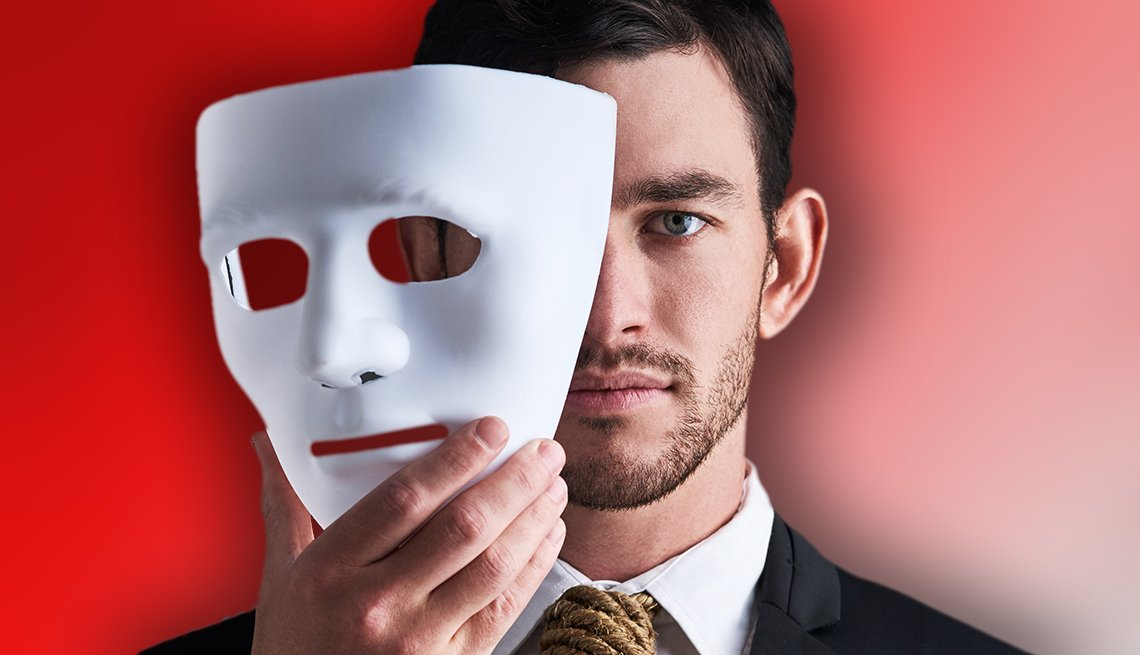a man holding a mask
