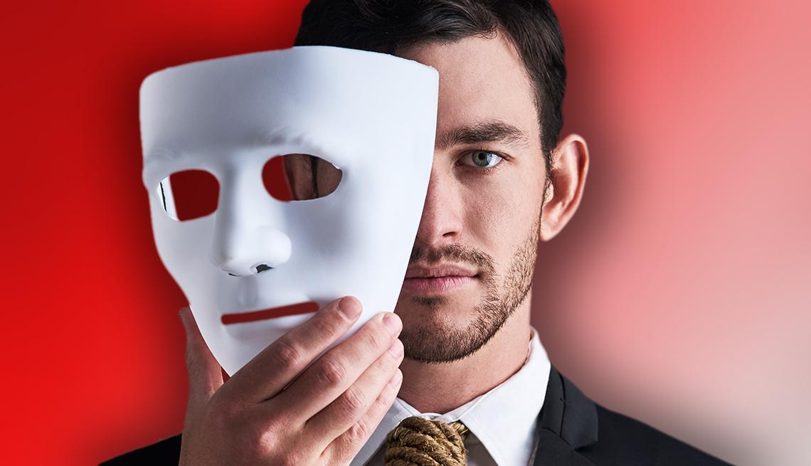 a man holding a mask