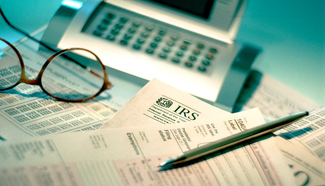 IRS forms on table with calculator