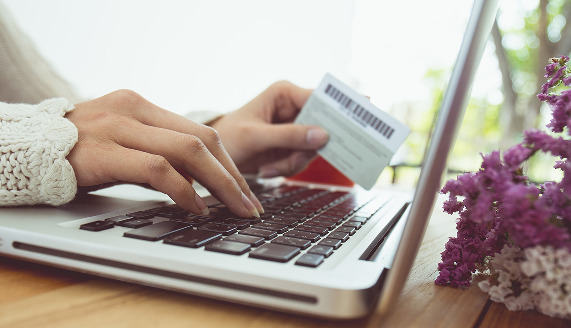 Close up of woman's hands with credit card online shopping