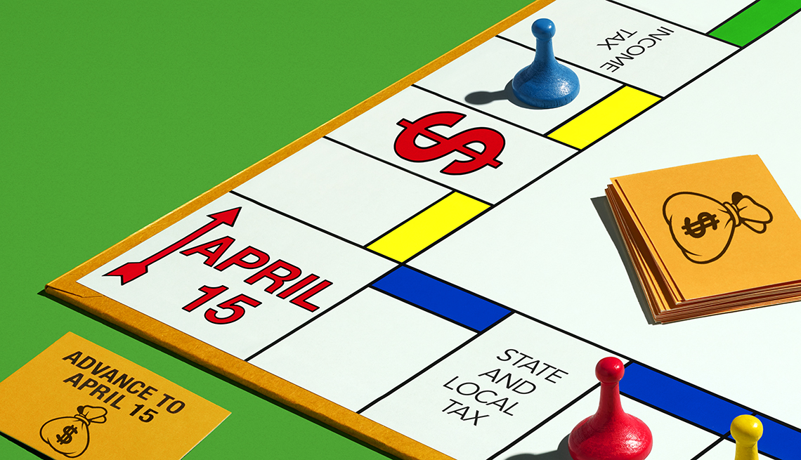 Monopoly board with tax dates on it