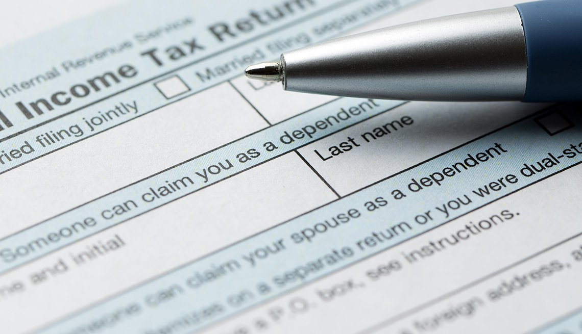 Tax return form with a pen on top of it