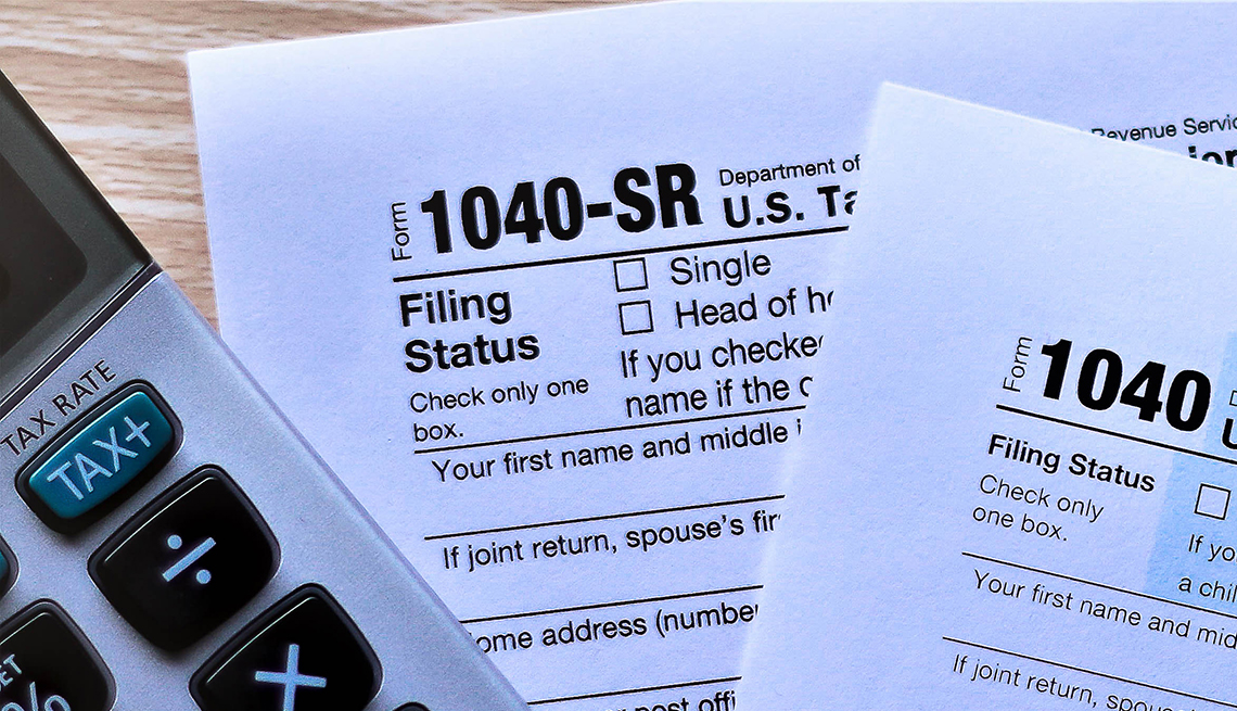 Forms 1040 and new Form 1040 SR for seniors on desktop