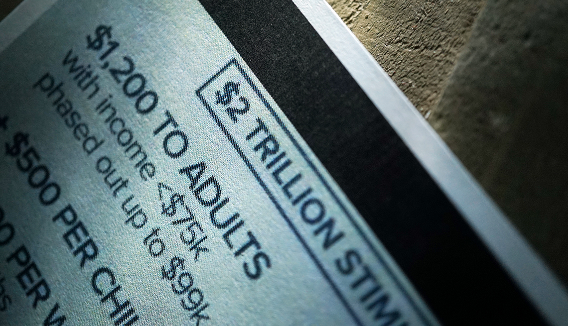 close up of printed card with details about the 2 trillion dollar stimulus package