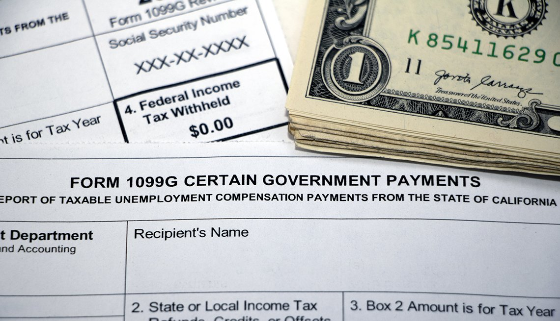 Closeup of overlapping tax forms, Form 1099G Certain Government Payments, Federal Income Tax Withheld <img data-g=