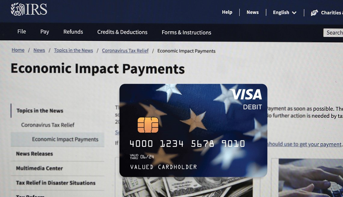 sample look at a stimulus payment debit card with a screen of the IRS website in the background