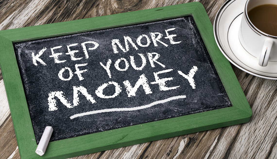 chalkboard sign on a table says keep more of your money