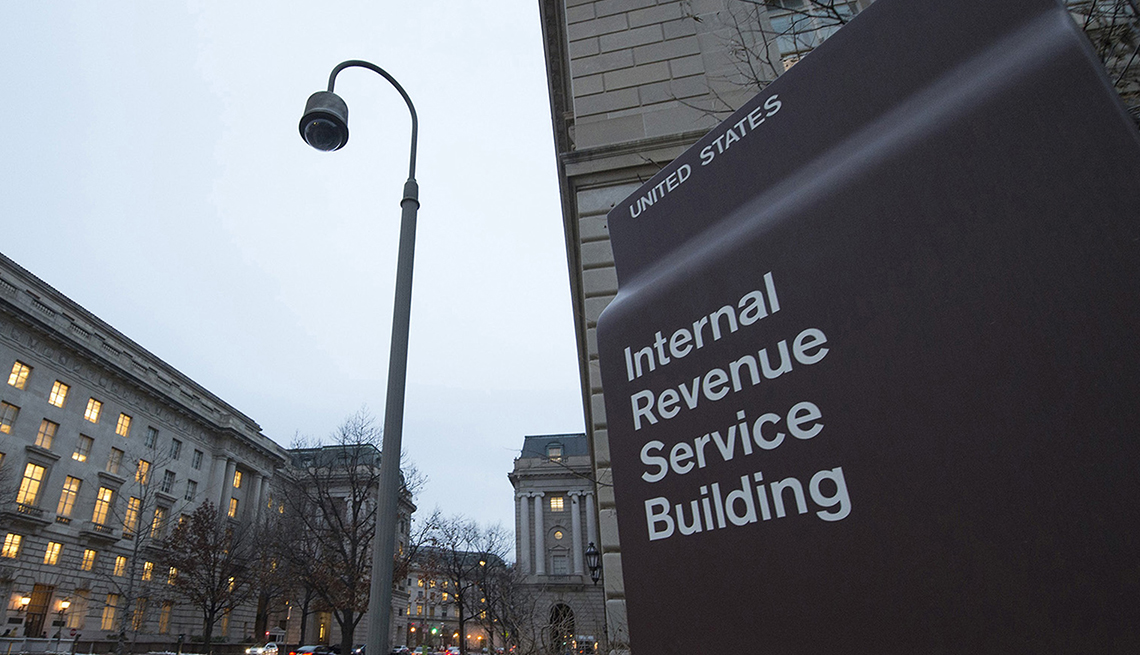 early evening photo of exterior of the Internal Revenue Service building sign in Washington D.C.