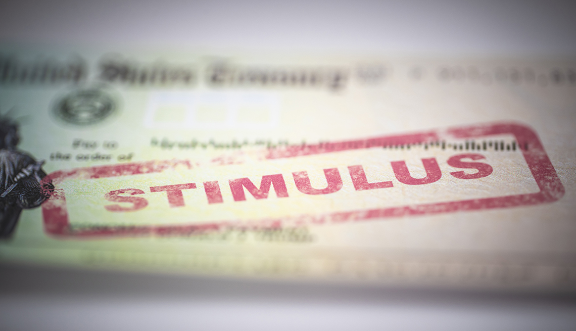 """The 2020 economic stimulus check with the word """"stimulus"""" stamped in red ink."""