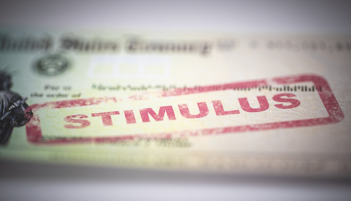 "The 2020 economic stimulus check with the word ""stimulus"" stamped in red ink."
