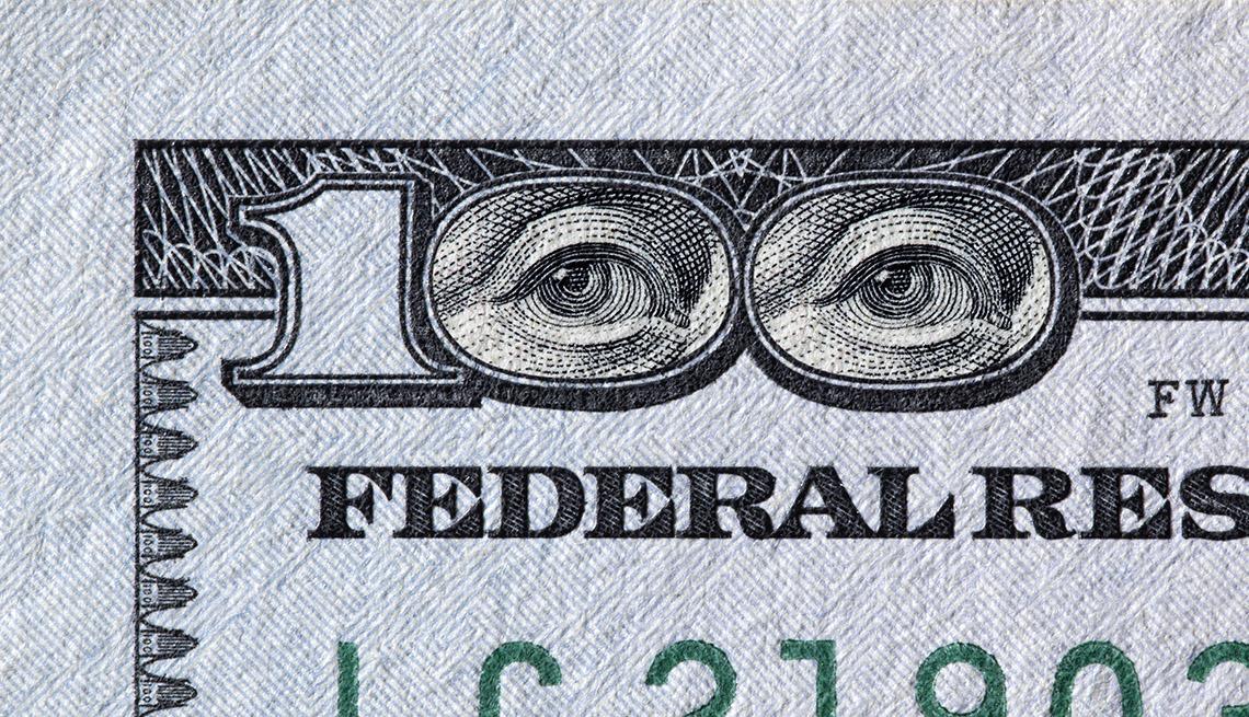 Benjamin Franklin eyes in the 100 dollar bill number