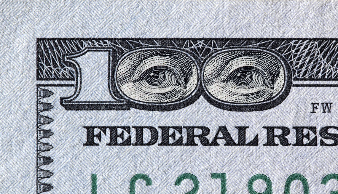 Benjamin Franklin eyes in the 100 dollar bill number