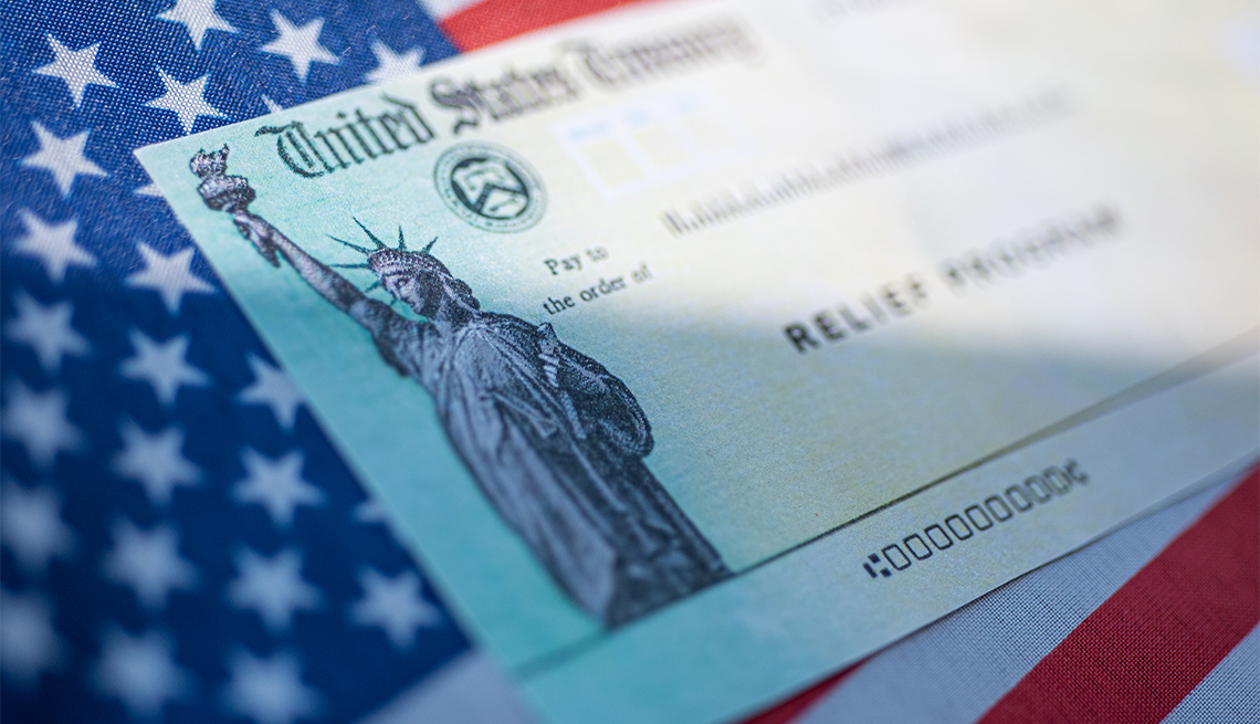 stimulus check on top of American flag
