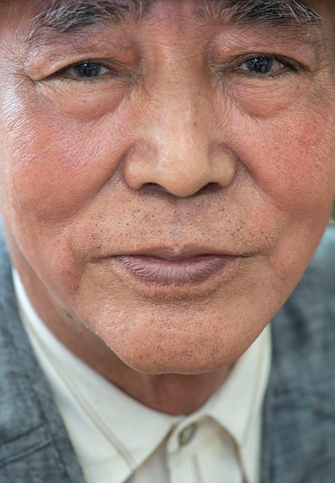 JAPAN. Kitanakagutsu, Okinawa. 2019. Hajime Katgoka (75) at a drop-in Day Care Centre. Elders can use these centers and their accomodations which include: spa treatments, community activities, and nurses, free of cost.