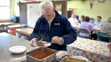 Joe MacFarlane helps prep for Meals on Wheels at the Whipple Senior Center.