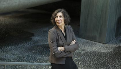 TURN Communications Director Annie Spatt stands for a portrait in San Francisco's financial district - California advocate for lower utility rates