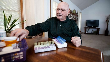 Tom Beisner preparing his pill organizer, Beisner participated in You Earned A Say