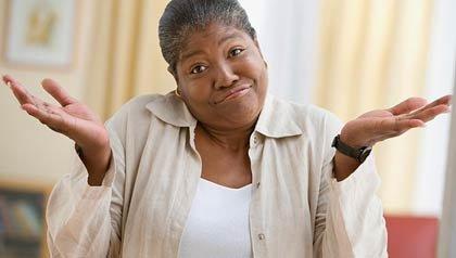 Una mujer se encoge de hombros - ¿Qué es el índice de precios al consumo?