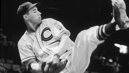 Full-length image of baseball pitcher Bob Feller of the Cleveland Indians winding up for a pitch during practice, Editor's Letter AARP Bulletin May 2013