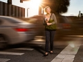 Woman walks cautiously across a highly trafficked street in Orlando, Pedestrian Safety