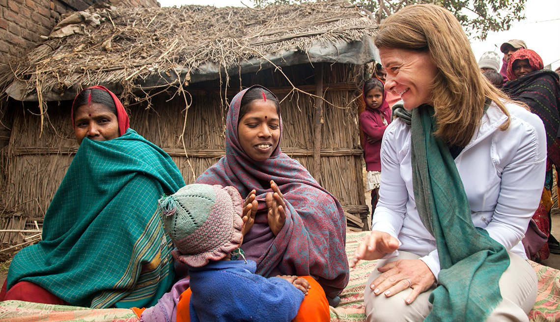 Melinda Gates interacts with Sharmila Devi, who has recently given birth to a girl (carried under her shawl), at her home in Dedaur village in Bakhtiarpur block of Patna district.