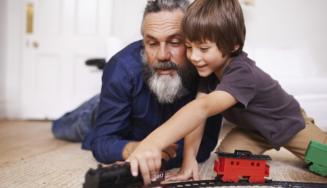 Grandfather and Grandson playing with a train set, Jenkins: Future of Social Security and Medicare