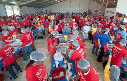 Volunteers pack meals during AARP Foundation's