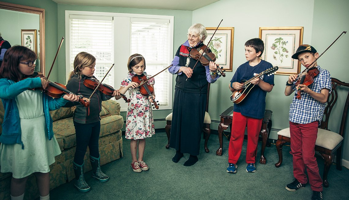 The Rev. Belle Mickelson, 68, with student musicians in Cordova, Alaska.