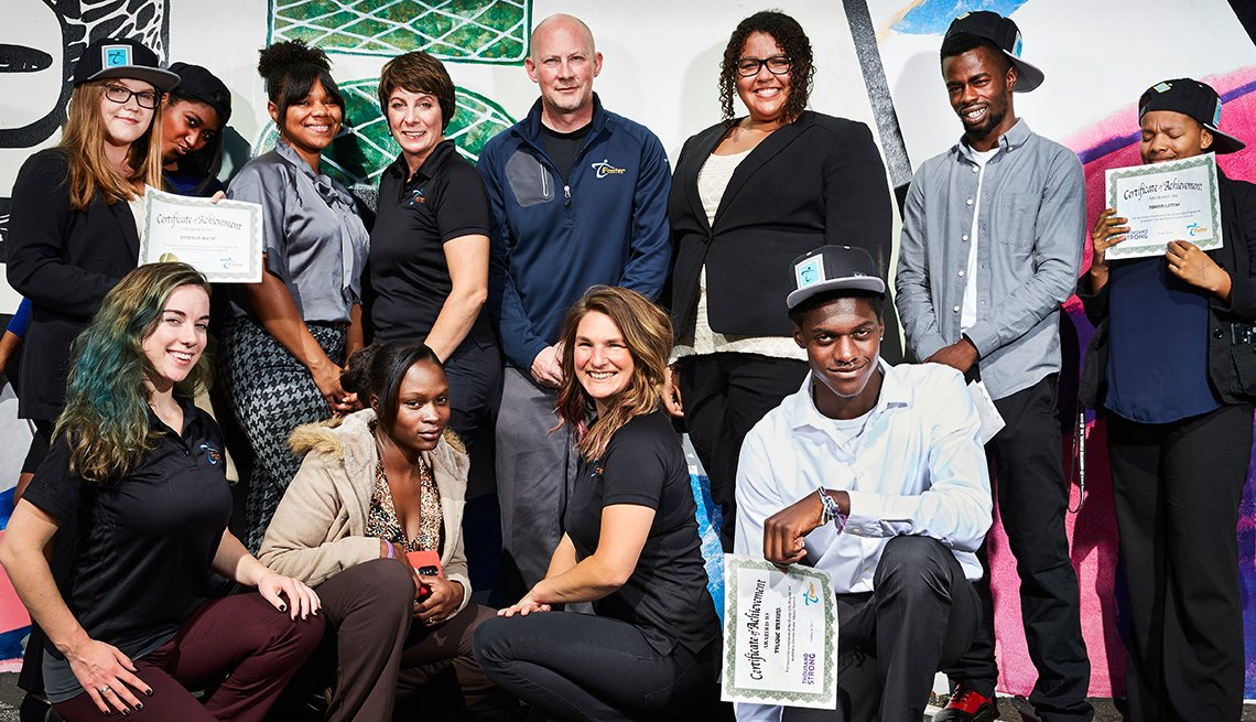 Living Lives With Purpose Reid Cox with wife Serita (to his right) and foster-care youth in the iFoster program that he created