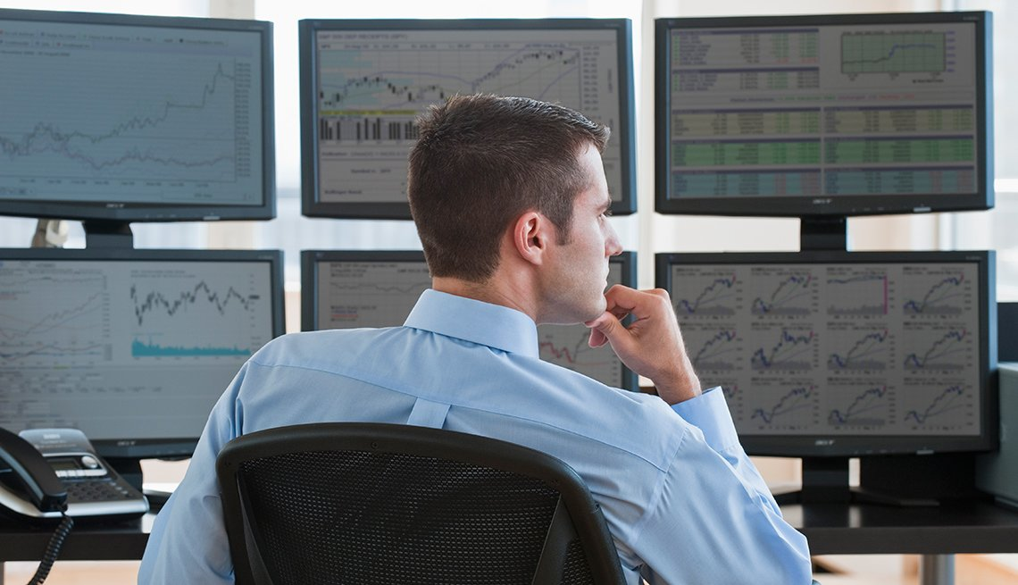 Broker sitting in front of screens