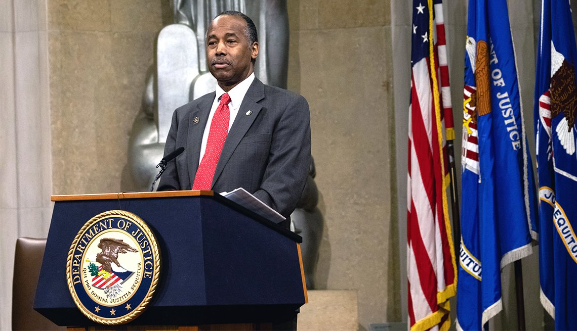 Benjamin S. Carson Sr. delivers a speech from behind a podium